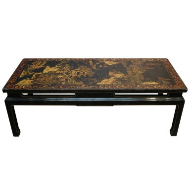 A Chinoiserie Black Lacquer and Gilt Decorated Coffee Table