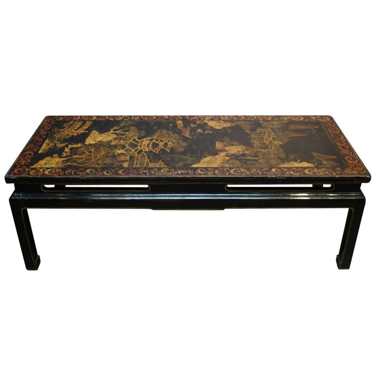 A Chinoiserie Black Lacquer and Gilt Decorated Coffee Table For Sale