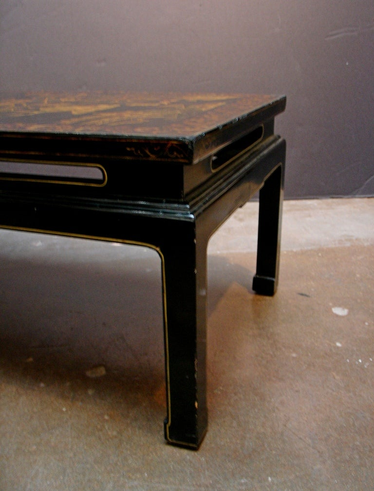 A Chinoiserie Black Lacquer and Gilt Decorated Coffee Table For Sale 1
