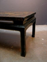 A Chinoiserie Black Lacquer and Gilt Decorated Coffee Table image 6