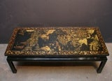 A Chinoiserie Black Lacquer and Gilt Decorated Coffee Table image 3