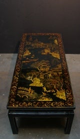 A Chinoiserie Black Lacquer and Gilt Decorated Coffee Table image 4