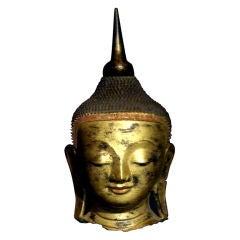 A Burmese Gilt Dry Lacquer Head of the Buddha