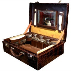 An Art Deco Gentleman's Alligator Traveling Vanity Case