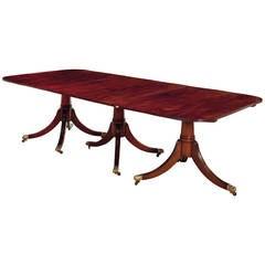 An English Mahogany Triple Pedestal Dining Table, 20th Century