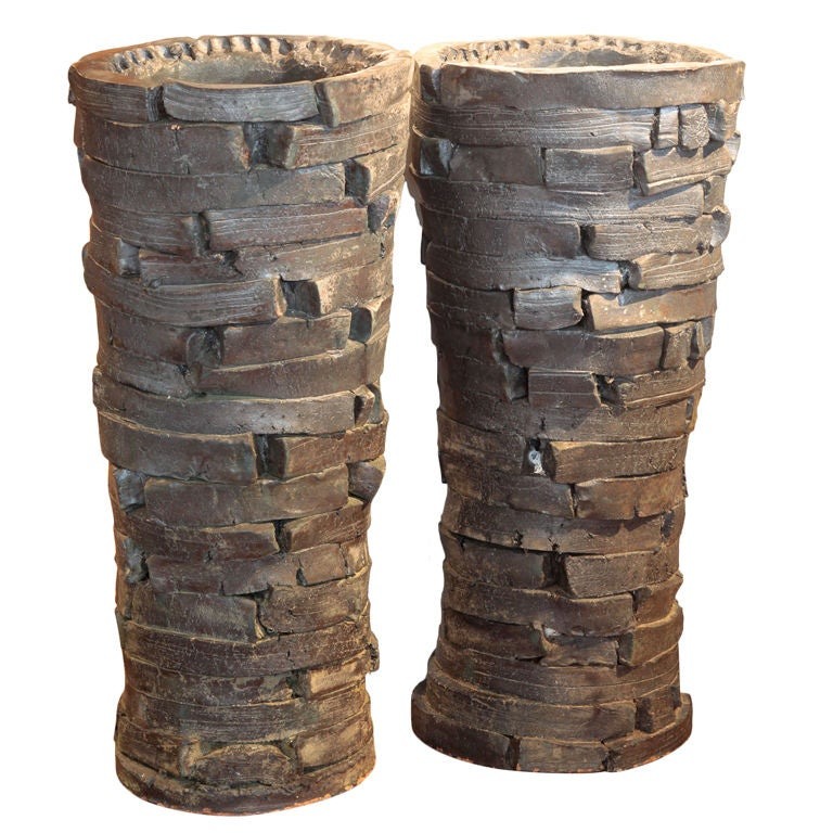 Massive pair of peter lane glazed clay floor vessels at