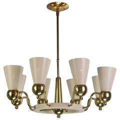 An American Brass and Cream Eight-Light Chandelier