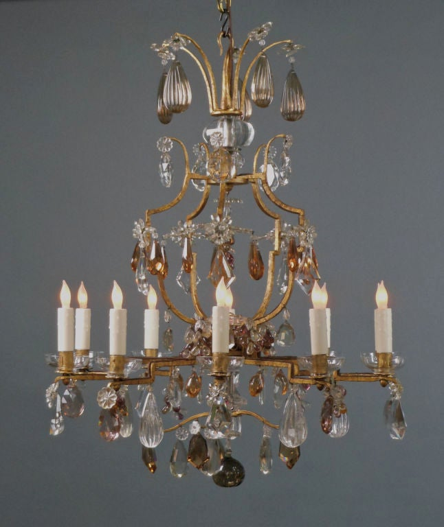 A French Gilt Iron And Cut Crystal Chandelier For Sale At