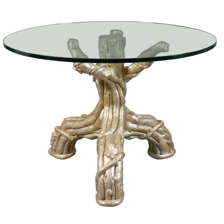 A French Silvered Tree Trunk Table With A Glass Top For