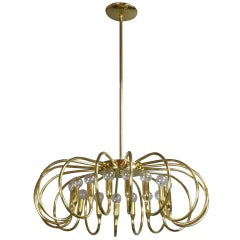 A Mid-Century Modern Brass Sixteen-Light Chandelier