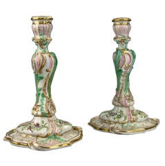 A Pair of Meissen Rococo Parcel Gilt Polychrome Candlesticks