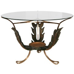 A 1940s Italian Brass and Carved Wood  Cocktail Table
