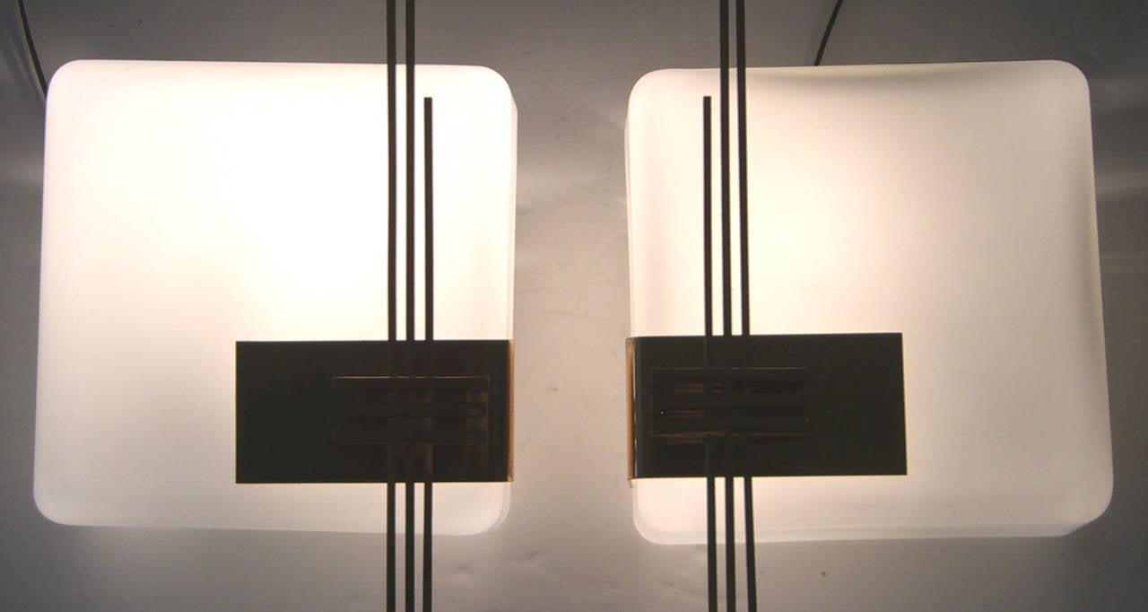 A pair of opaque white glass box form wall sconces with gold-plated metal design features. All wiring is new for the US.