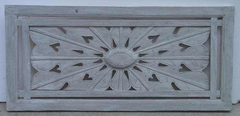 Beautiful wall hanging made of wood hand carving of interesting motifs of starburst drops and hearts motifs hand-painted in white grey color