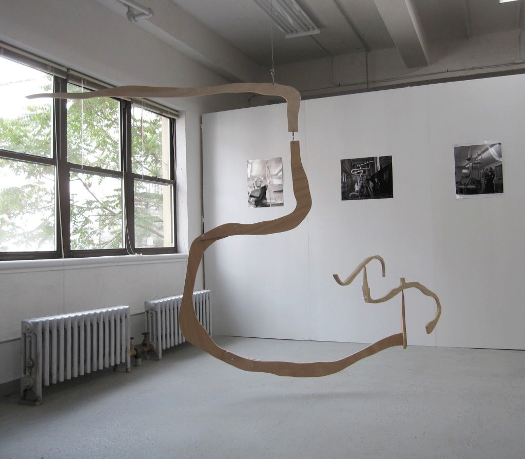 A stunning and poetic mobile sculpture by Jacques Jarrige. Wide fascinating movement created by meandering wood pieces screwed together and two balancing branches.