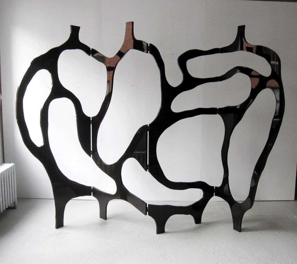 Sculpture/room divider in hand painted Black Lacquer by Jacques Jarrige.  The openwork frame embodies Jarrige's line and traces a joyous abstract dance across four panels. The Space comes alive: the voids and the solids become vibrant.