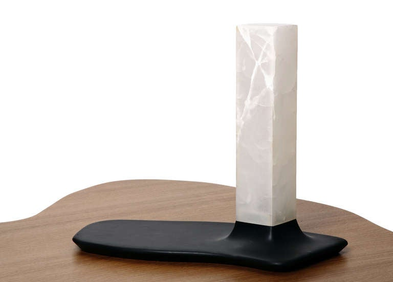 """""""Colosse"""" created by Adrien de Melo for Valerie Goodman Gallery is a pair of table lamps made of slate and Onyx. The large slate bases appear like feet belonging to glowing white onyx legs formed by the shade.  Edition of eight. Sold"""