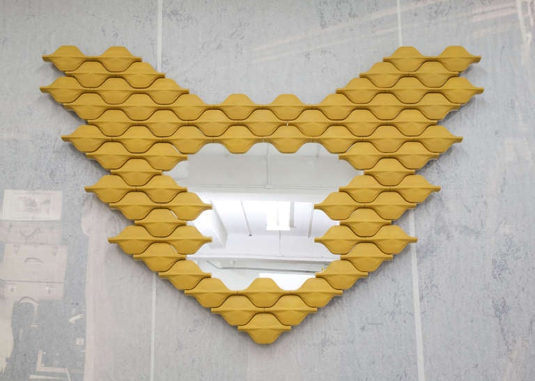 """""""Butterfly"""" is a ceramic tile wall piece and a mirror. The tile is inspired by the Portuguese Azulejo but reinterpreted in 3D by French designer Adrien de Melo. The repetition of the motif gives this piece the feeling of escaping"""