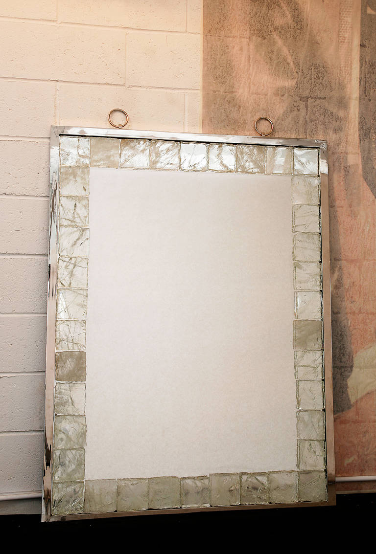 This splendid mirror tiled with rock crystal and framed with nickeled brass is equipped with a light system.