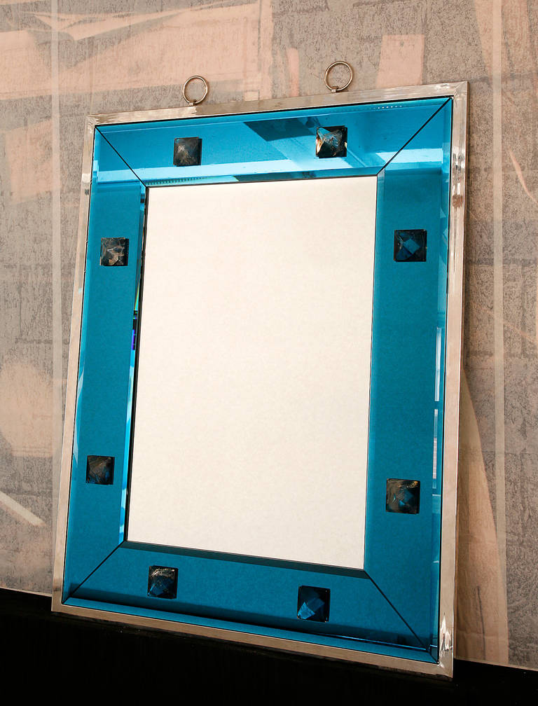 Great mirror with blue frame glass decorated with rock crystal studs. Exterior frame in nickeled brass  Custom size is possible.