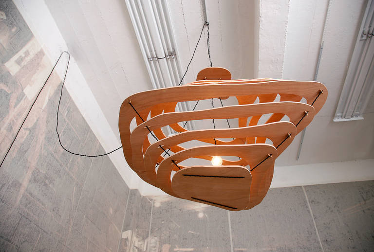With this new suspension Jacques Jarrige pursues his focus on creating an environment rather than an object. This simple yet arresting and functional light is hand-cut from a single piece of plywood, reminiscent of the meandering created by