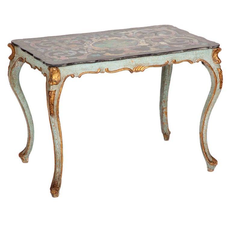 This fine mid eighteenth century Italian rococo scagliola table top is decorated with polychrome curling foliate motifs around a central oval, all on a black ground, with a curving shaped edge. Scagliola is a technique that developed in Tuscany to