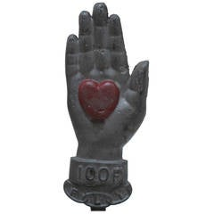 Painted Iron Heart in Hand Sculpture
