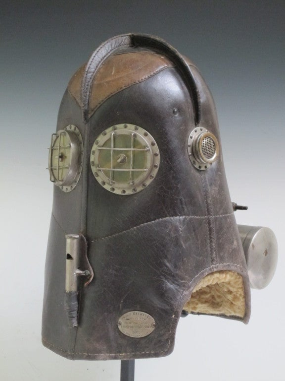 The Vajen Helmet revolutionized firefighting in the late 19th c. Allowing firemen to carry their own oxygen supply and giving full protection to the men from smoke and falling debris.  Made in Indiana the mask label lists patents from 1891 to 1900.