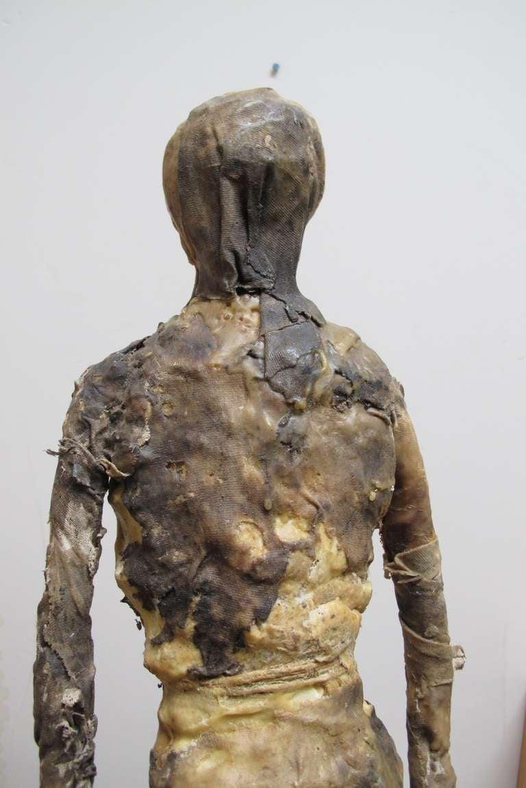 Primitive Larry Calkins Sculpture Leathering
