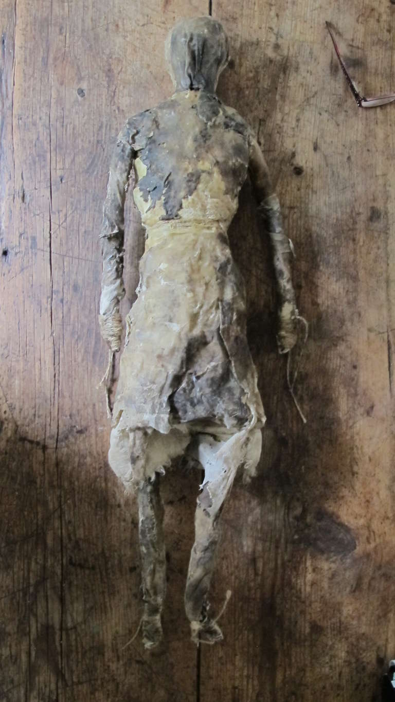 Enigmatic sculpture made from cotton cloth, cord and beeswax by self taught artist Larry Calkins. The figure is probably built over an under structure to retain its form. Part of it' appeal is the mottled earth toned surface with earth pigments and