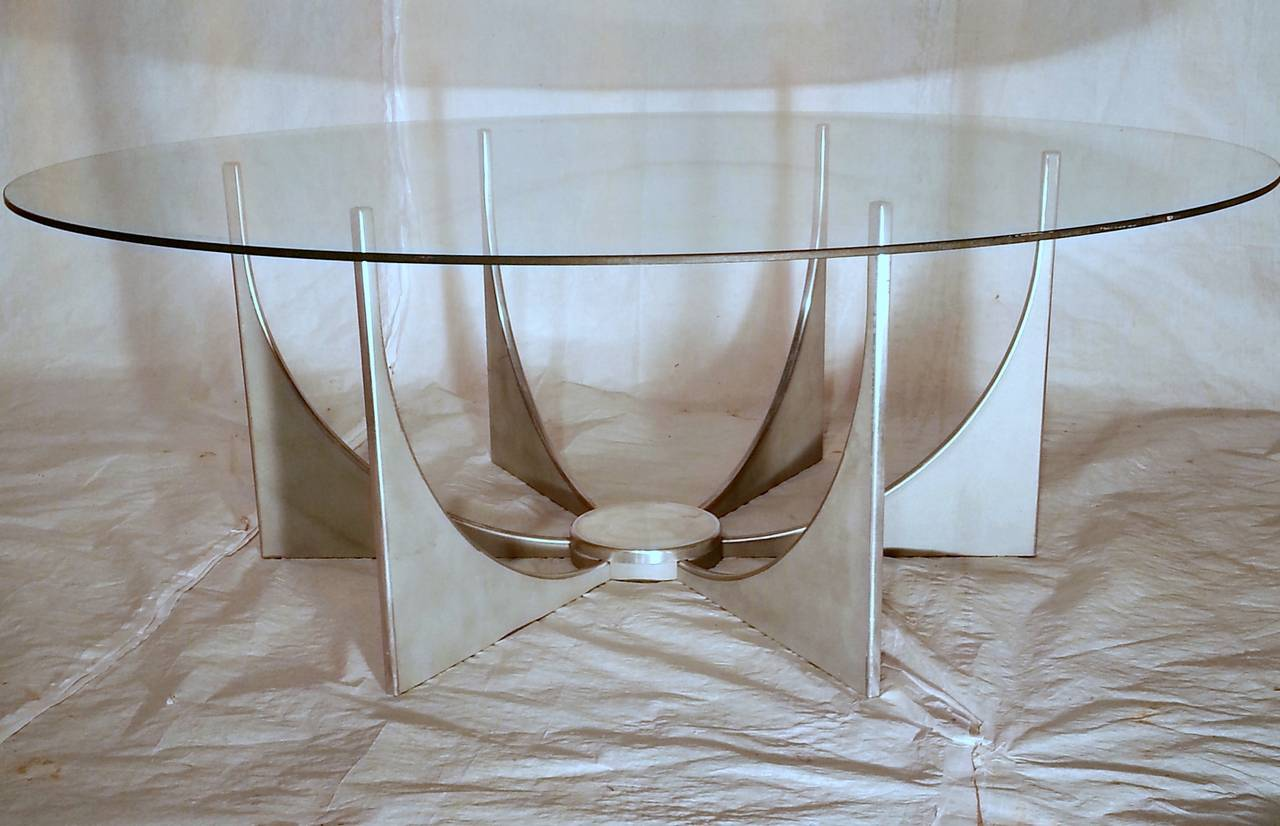In the style of Donald Drumm an unusual example of a Minimalist aluminum based coffee table with its vintage 40