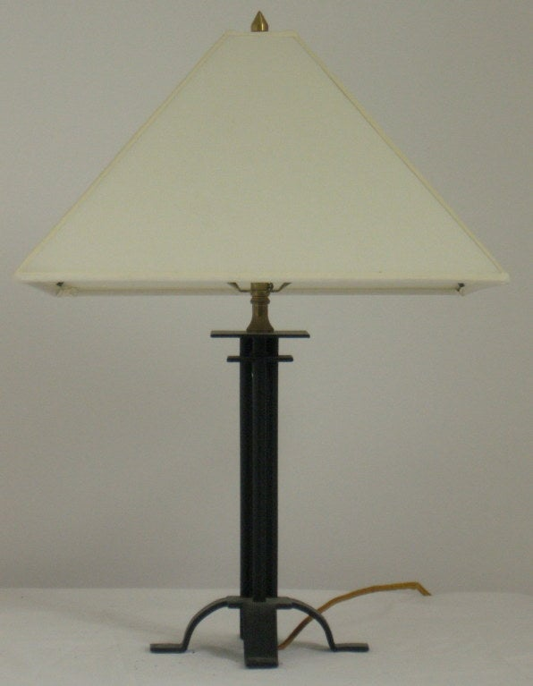 Classic wrought iron table lamp designed by Warren McArthur's older brother Albert Chase McArthur, architect of the Arizona Biltmore in Phoenix, Arizona.   The McArthur's commissioned the local veteran's hospital for disabled World War I