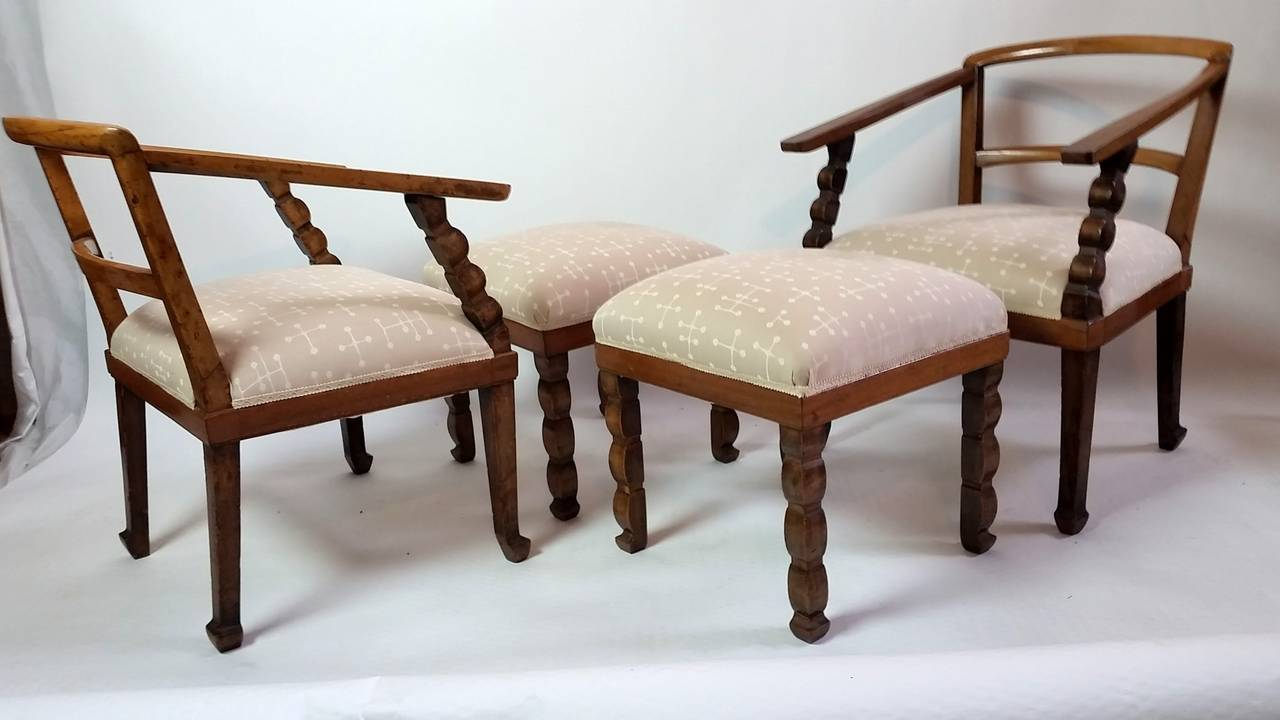A pair of carved sculptural Venetian Art Deco fruit-wood lounge chairs with matching ottomans.  Newly upholstered.  The chairs measure: H. 28