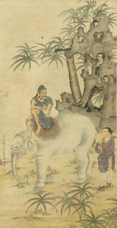 Antique Chinese scroll painting, circa 1920 depicting a sage riding an elephant.  Executed with a descriptive inscription and the Artist's chop stamp on the lower left of the panel. The painted paper panel measures 47.5