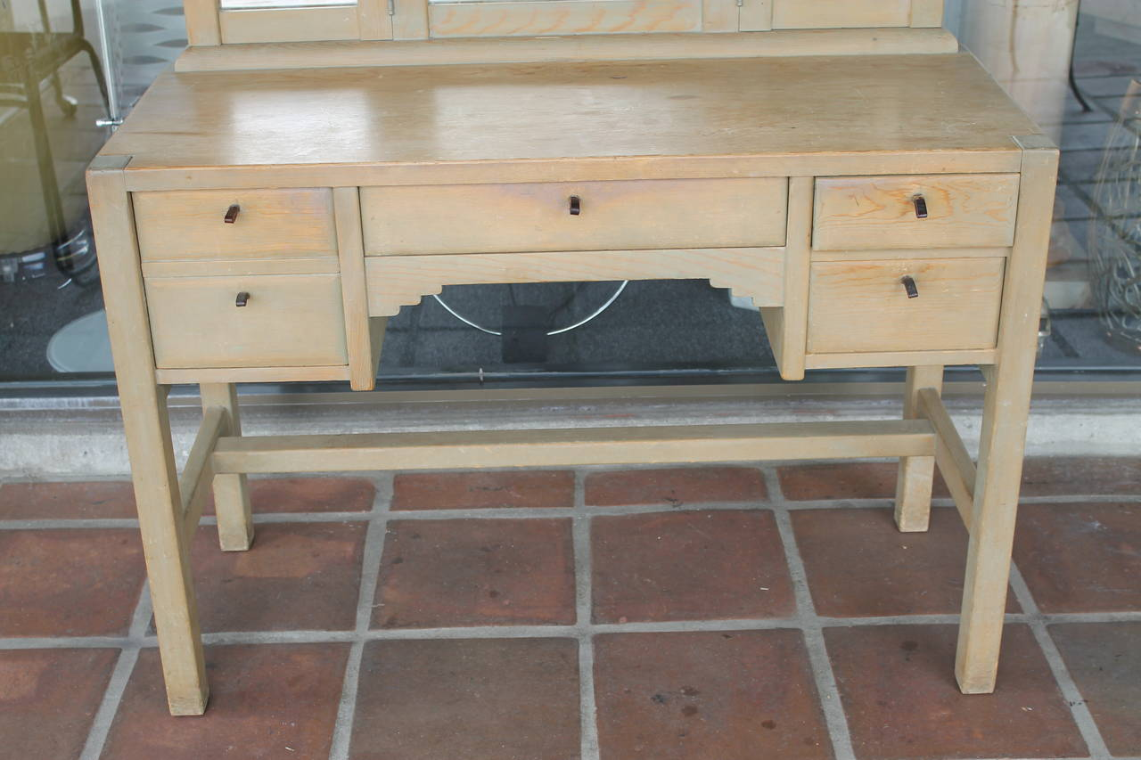 New Mexican vanity or desk with original glass and patina. It seems three of the drawer pulls have been redone. Measures: Total height is 61
