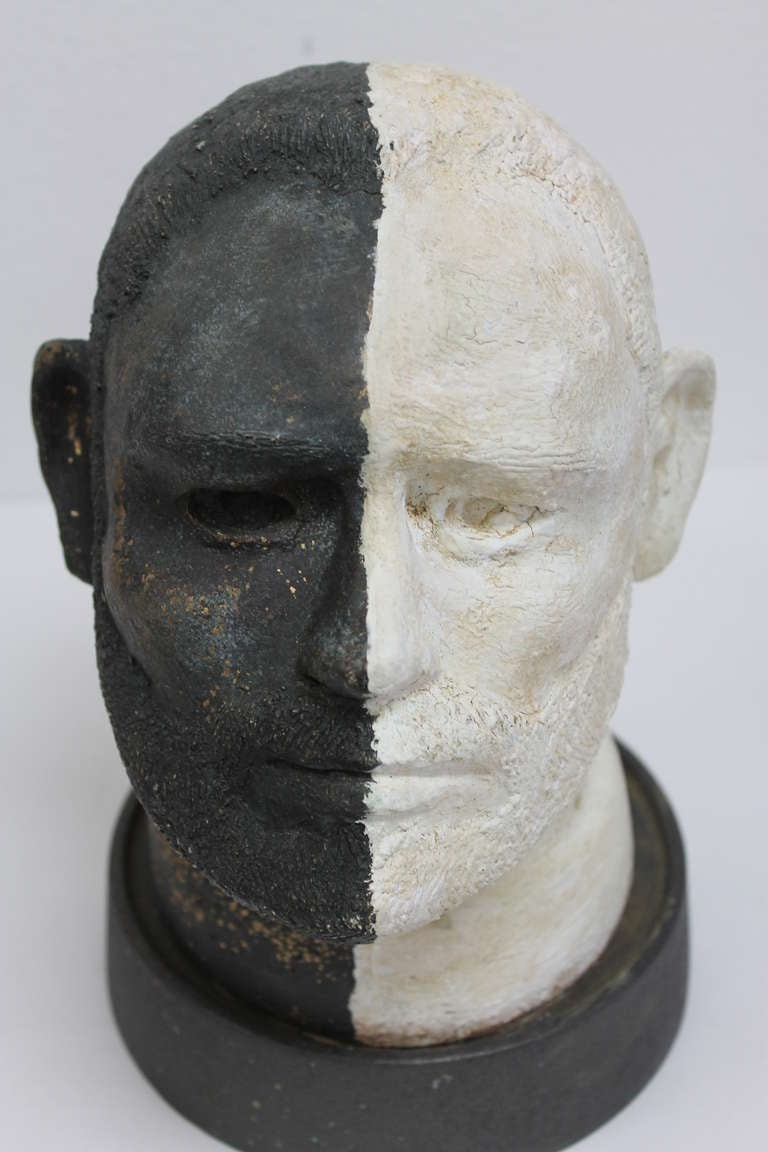 Artist signed black and white ceramic head. We cannot make out the signature. Picture is included. The head measures 6.5