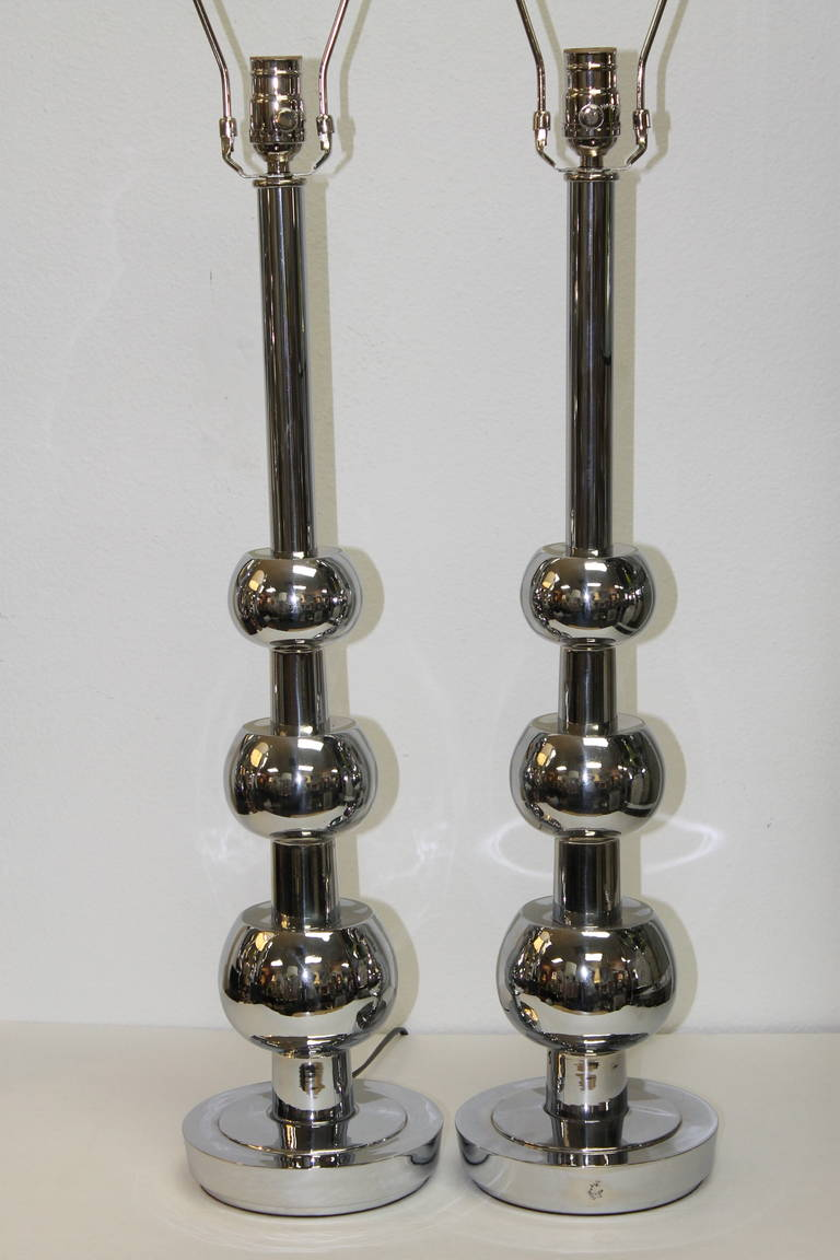 Chrome table lamps by Stiffel, circa 1960s. Lamps were originally brass and we had them re-chromed. Lamps are professionally rewired.  Total height from base to the top of socket is 27 inches.   Lamp shades not included.  Stiffel lamps are the