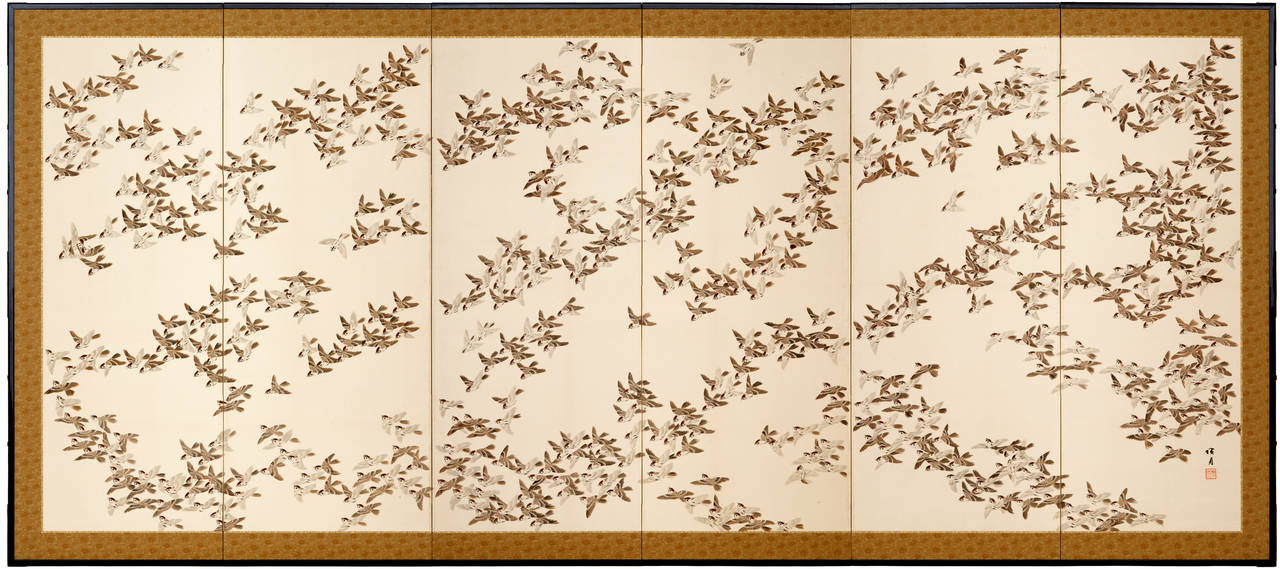 Ink and mineral colors on paper.  Pair of six-panel screens with fine painting in ink and color on paper of one thousand flying birds, all delightfully different.