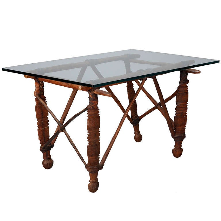 Cocktail table with 19th c african wood and leather base for sale at 1stdibs African coffee tables