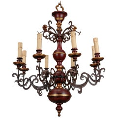 Eight Light Italian Wood and Scrolled Iron Chandelier