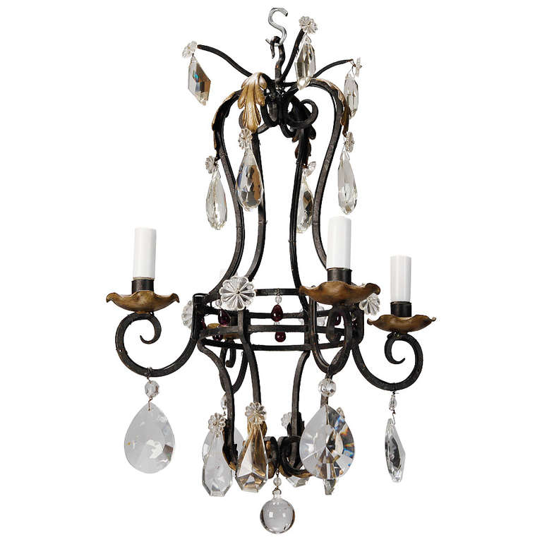 French Four Light Black Iron And Crystal Chandelier For
