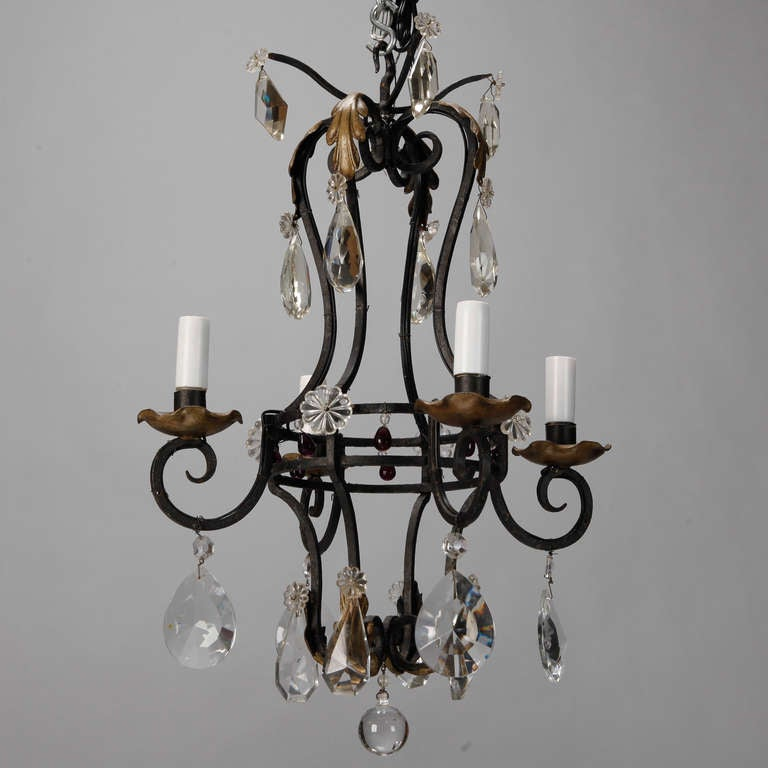 Circa 1930s Black Iron Chandelier With Scrolled Arms Four Candle Style Lights Gilded Bobeches