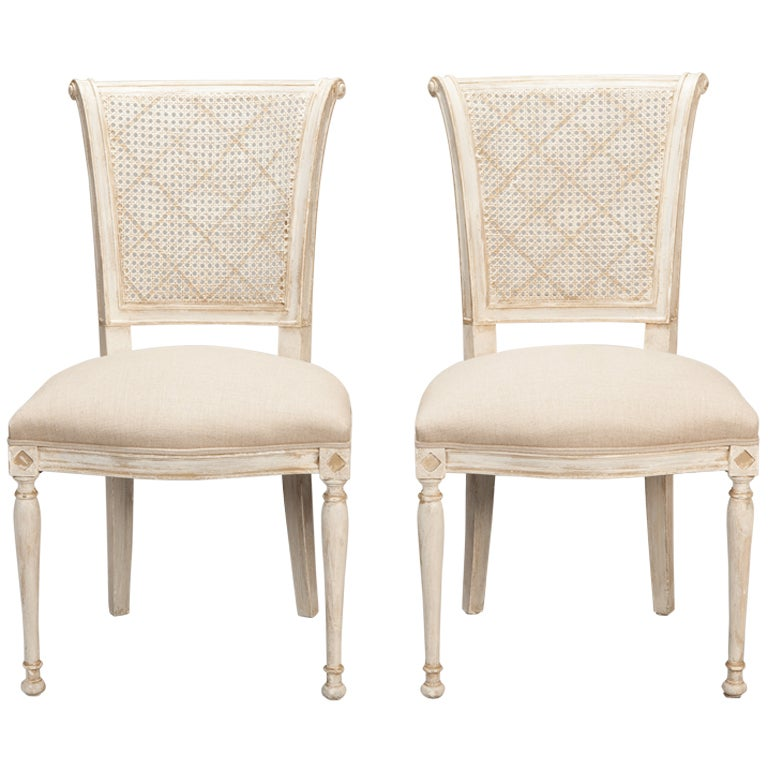 Set of 12 french cane back antique white dining chairs at for White dining room chairs