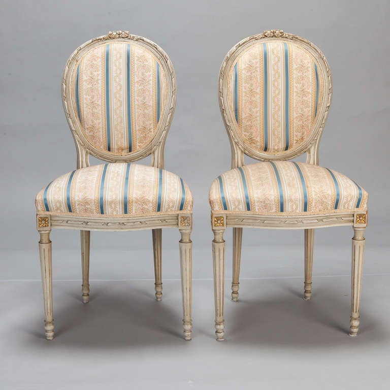 """Set of eight French dining chairs with rounded backs and classic striped and floral upholstery.   Seat Height:  21"""" Seat Depth:  17"""""""