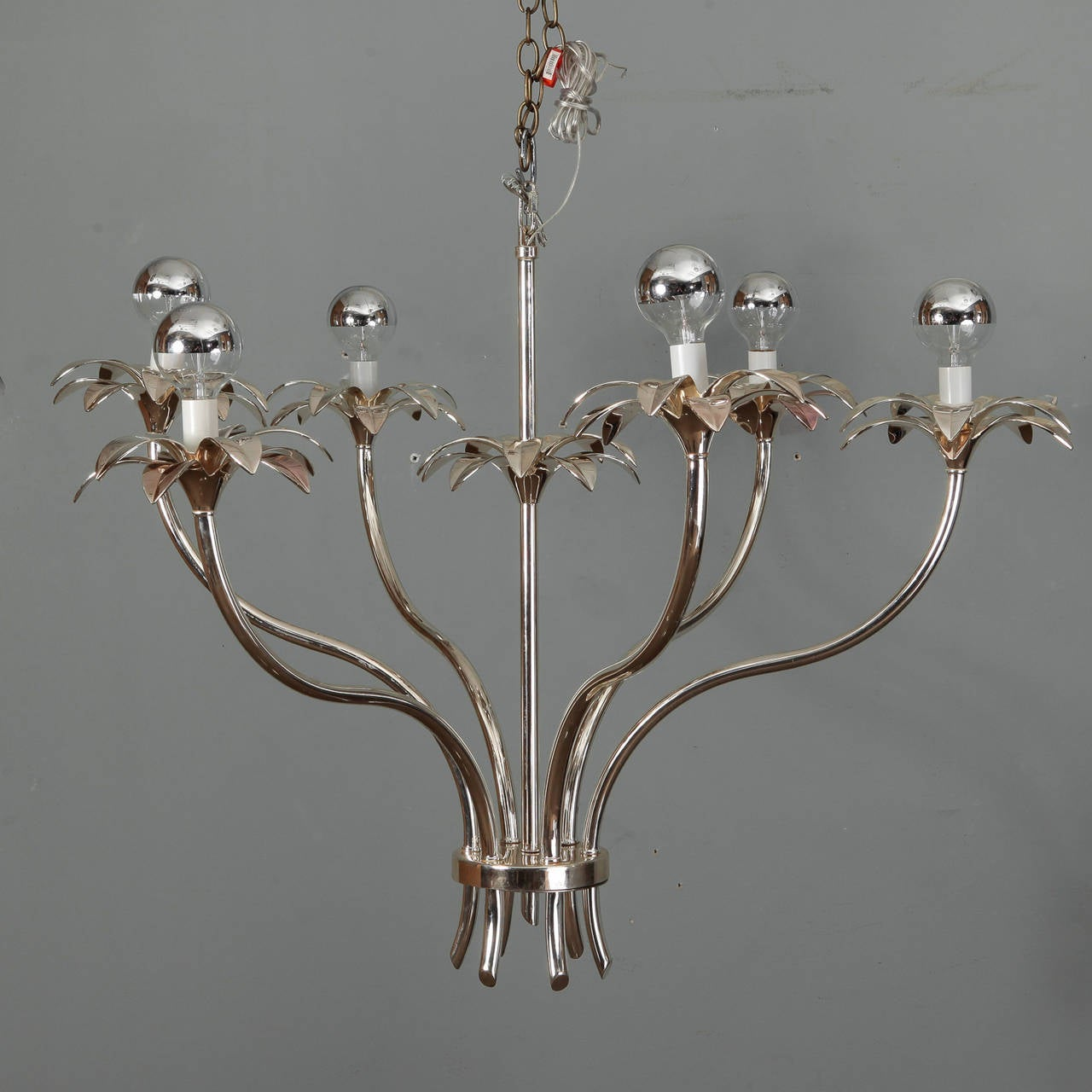 Pair of sculptural, floral and stem form chandeliers have six arms and nickel frames. Found in France, circa 1960s, unknown manufacturer. New wiring for US electrical standards. Sold and priced as a pair.
