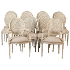 Set of Twelve Painted and Caned Back French Dining Chairs