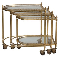 Three Piece Neoclassical Brass and Glass Nesting Tables on Casters