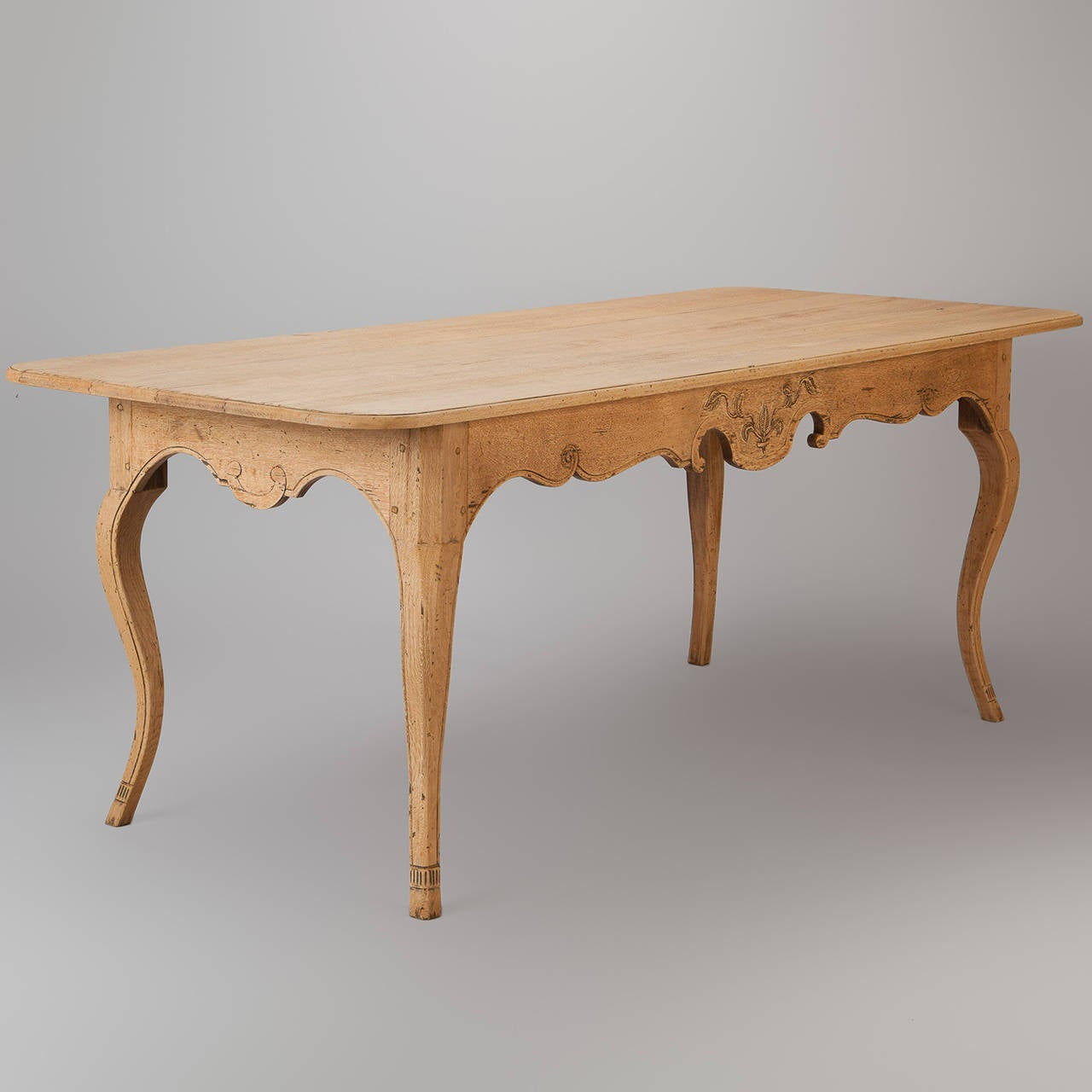 French Bleached Table With Carved Detailing And Curved