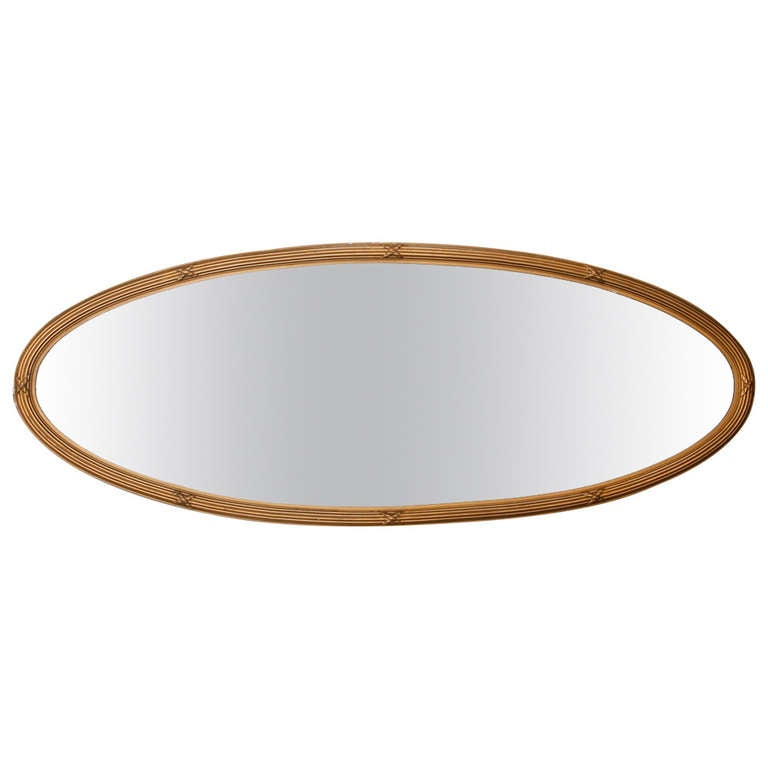 French narrow oval gilded mirror with beveled glass at 1stdibs for Narrow wall mirror decorative