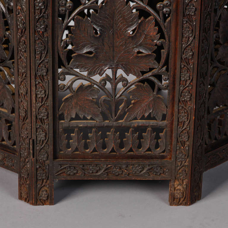 Octagonal delicately carved dark wood moorish table at